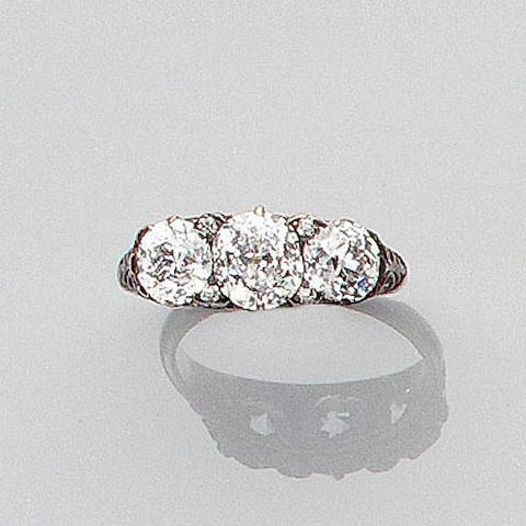 A late Victorian diamond three-stone ring