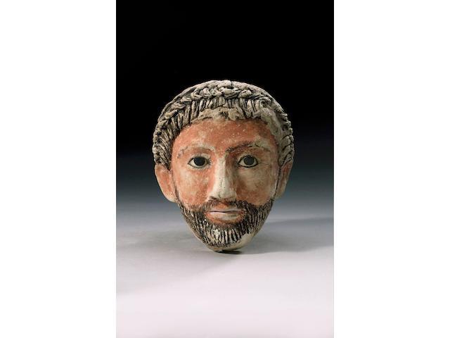 A Romano-Egyptian stucco male funerary portrait mask