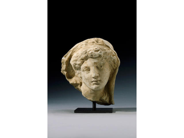 A Hellenistic marble head of a veiled woman. Ex Gorny and Mosxh, Munich. A stand being made by Colin
