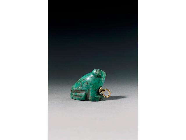 An Egyptian turquoise feldspar frog amulet,  Saite Period, circa 664-525 B.C.