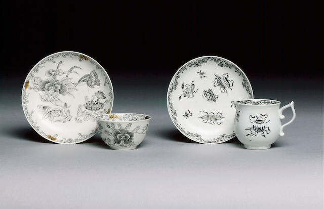 A Worcester teabowl and saucer pencilled in black with Chinese flowers and butterflies, saucer 12.2c
