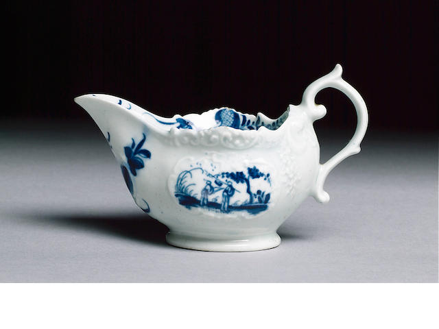 A Worcester creamboat with scroll moulding painted in blue with the Two Porter pattern, 7cm. high (m