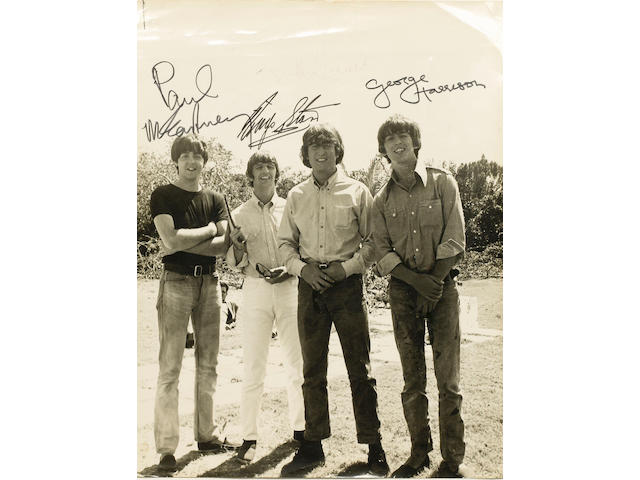 An autographed photograph of The Beatles 1965
