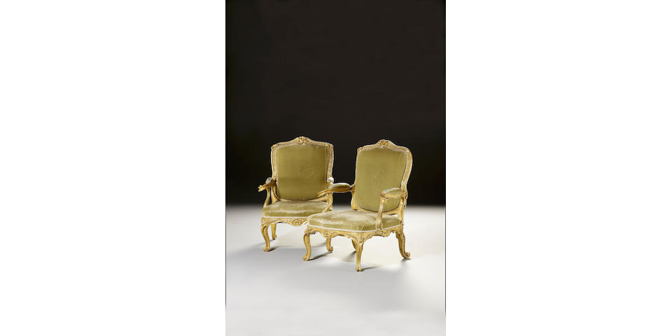 A fine pair of George III carved giltwood Open Armchairs,