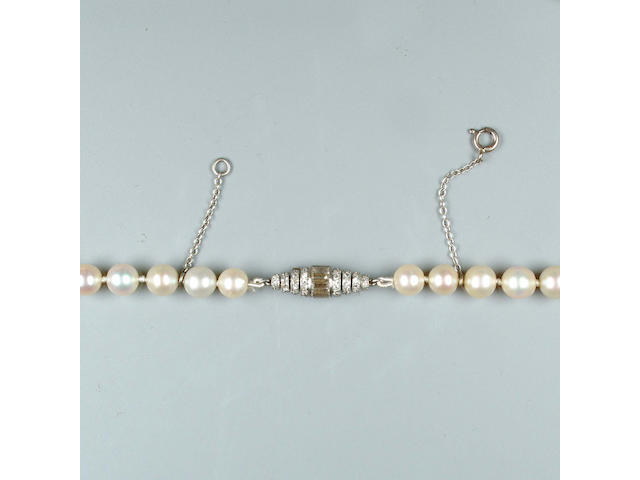 A single-strand natural pearl necklace with a Janesich diamond clasp,