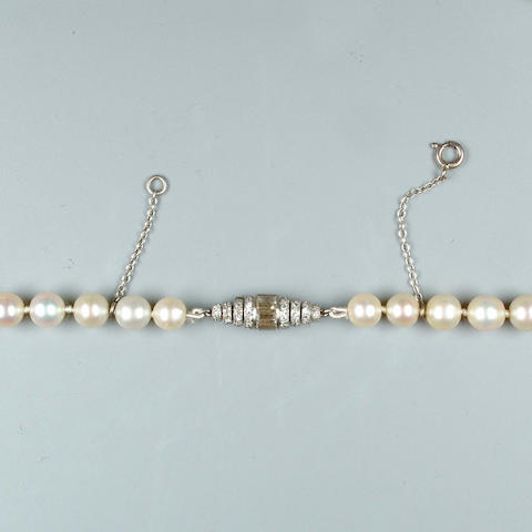 A single-strand natural pearl necklace with an art deco diamond clasp by Janesich