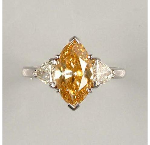 An orange/brown diamond single-stone ring