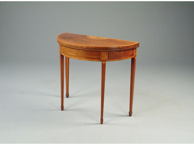 An 18th century mahogany & satinwood crossbanded card table