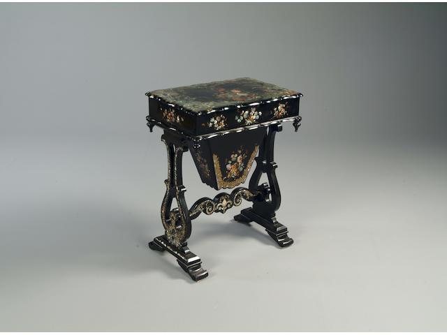 A Victorian papier mache work table
