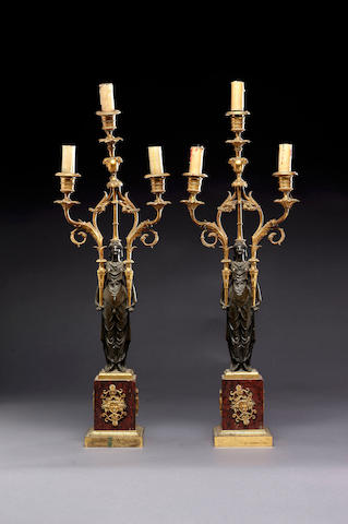 A pair of 19th century French gilt and patinated bronze three light figural table Candelabra,
