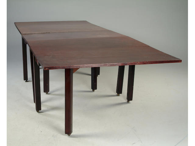 A mahogany gateleg action triple section dining table