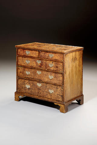 A George I stained burr elm and walnut Chest,
