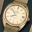 Omega. An 18ct gold automatic calendar bracelet watchLondon hallmark for 1968
