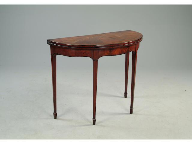 A George III mahogany demi-lune card table