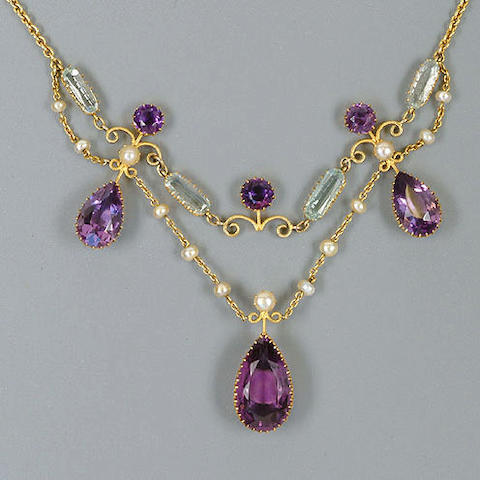 An Edwardian amethyst, pearl and aquamarine fringe necklace,