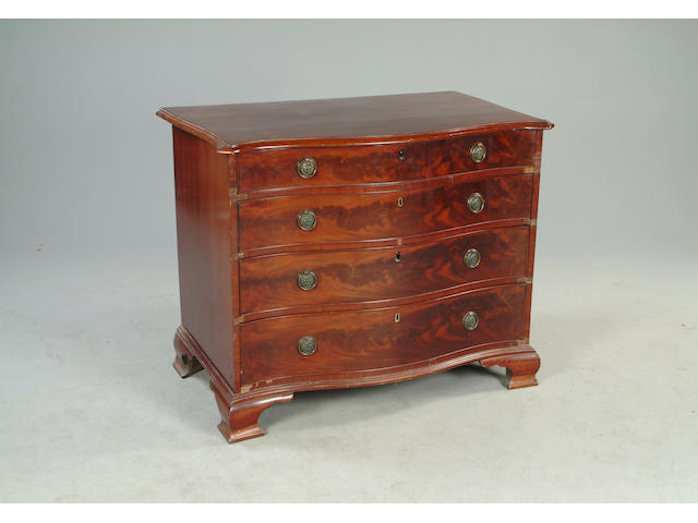 A George III style mahogany serpentine chest
