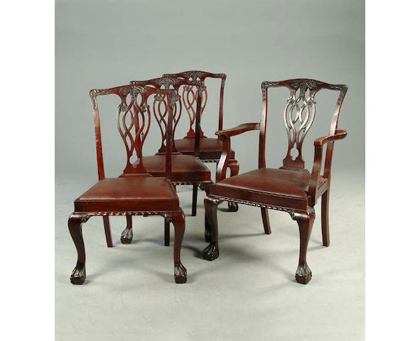 A set of eight George III style mahogany dining chairs, in the Chippendale taste