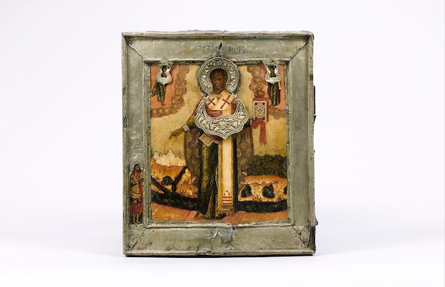 A Russian icon of St. Nicholas the Miracle worker, 18th century with white metal oklad, 32cms x 28cm