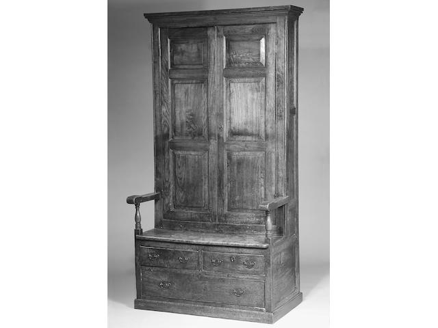 An 18th century elm bacon settle,