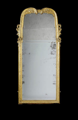 A George I carved giltwood Pier Mirror,