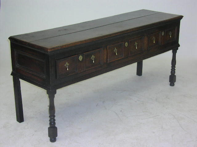 A 17th century oak dresser base,