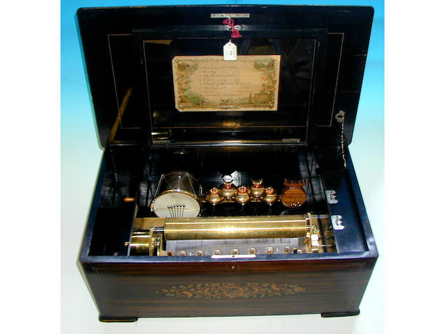 An Ami Rivenc drum, castanet and bells in view musical box,
