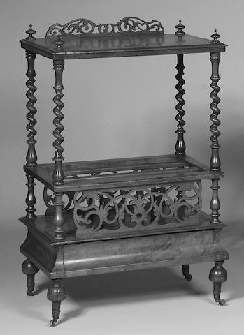 AN EDWARDIAN WALNUT CANTERBURY