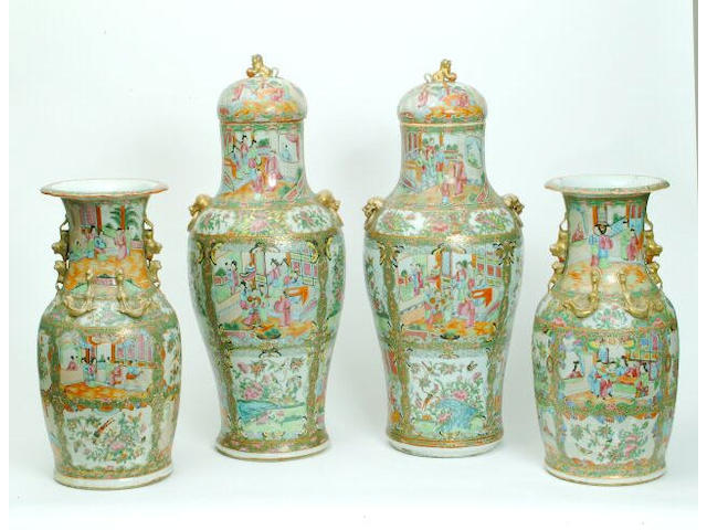 A pair of Canton Famille Rose floor vases and covers 67 cm high. (2)