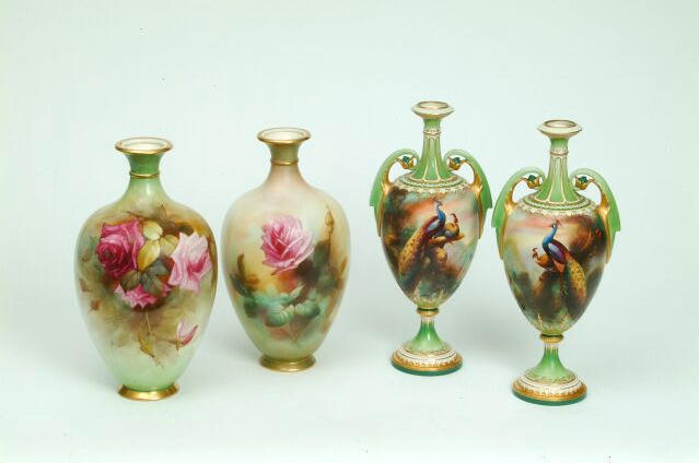 A pair of Royal Worcester James Hadley vases