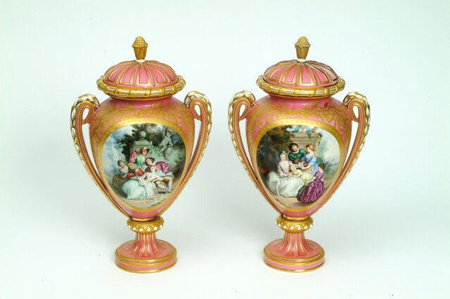 A pair of Royal Worcester vases and covers