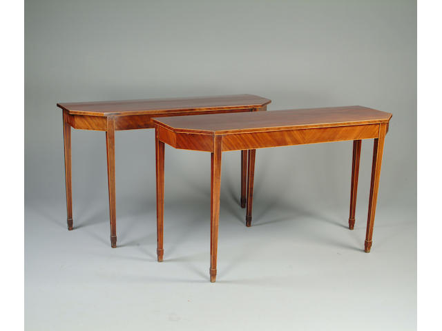 A matched pair of George III style mahogany side tables