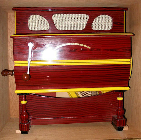 A reproduction Spanish style miniature barrel piano,