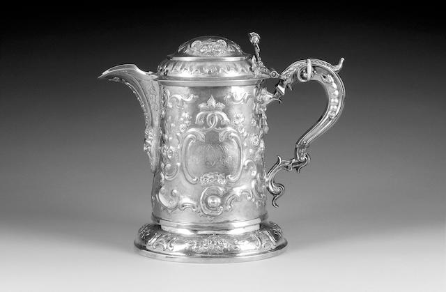 A George III Provincial silver tankard/jug with later modern additions (spout and handle), the cover different date and maker, the body by John Langlands, London 1775, the cover marks rubbed, lion passant visible only, the spout and handle with L.A.O marks London 2003,