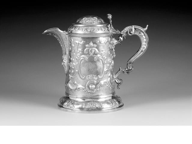 A George III Provincial silver tankard/jug with later modern additions (spout and handle), the cover