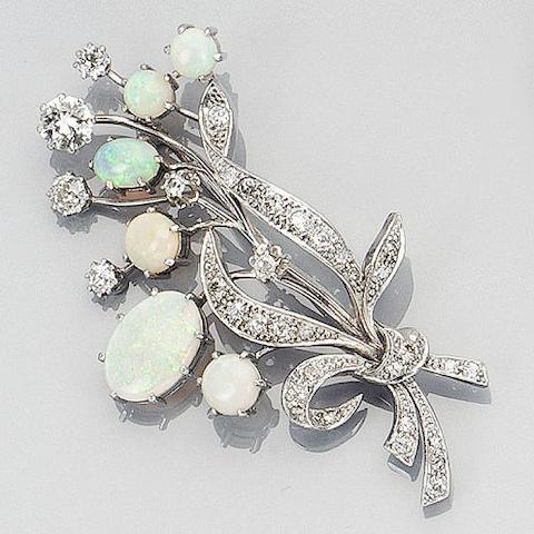 An opal and diamond floral spray brooch