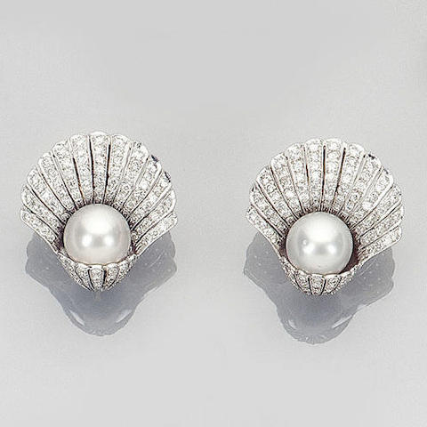 A pair of diamond and cultured pearl earclips
