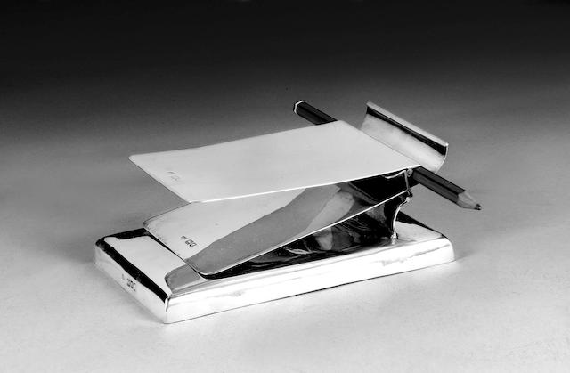 A silver desk pad holder, by Goldsmiths and Silversmiths, London 1910,