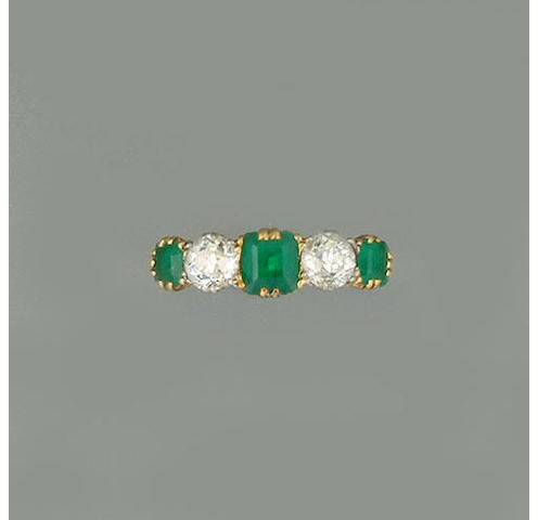 An emerald and diamond five stone ring