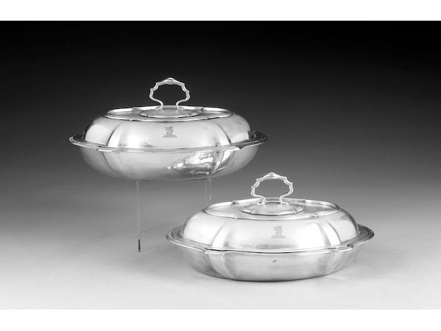 A pair of Edwardian silver shaped oval entrée dishes and covers, by Thomas Bradbury, London 1906,