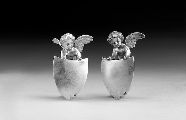 A set of four Victorian silver cherub mounts, by Edgar Finley & Hugh Taylor, no town mark or date letter,
