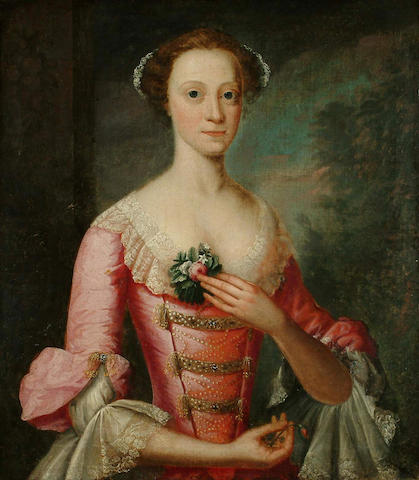 Circle of Thomas Hudson Portrait, half length, of a young lady lady wearing a dusty pink satin dress decorated with pearls, gold braid and lace,