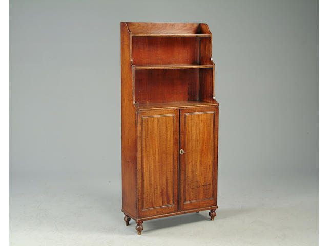 An early 19th Century mahogany and ebonised line inlaid dawrf waterfall bookcase