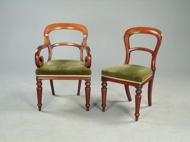 A set of seven Victorian mahogany balloon back chairs