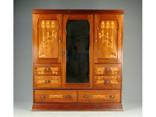 A late 19th Century mahogany and inlaid Art Nouveau bedroom suite comprising: