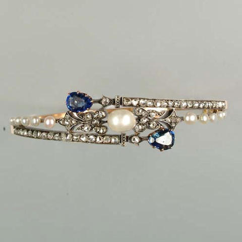 A late 19th century pearl, diamond and sapphire hinged bangle,