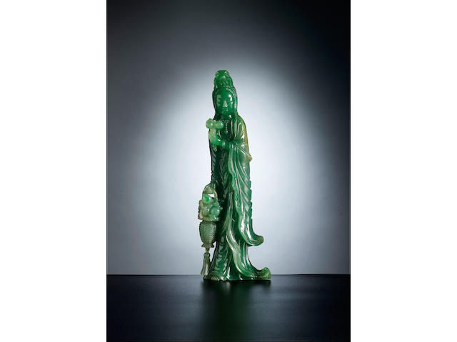 A very fine carved jadeite figure of Guanyin Late Qing Dynasty