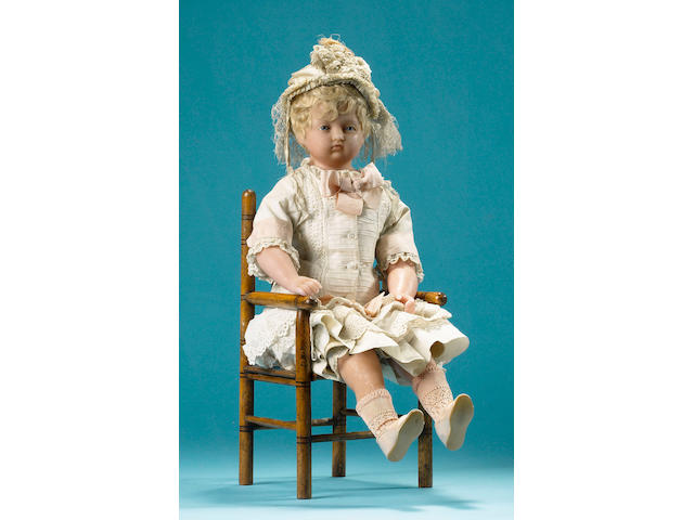 A rare poured wax portrait doll of Princess Louise, English circa 1845