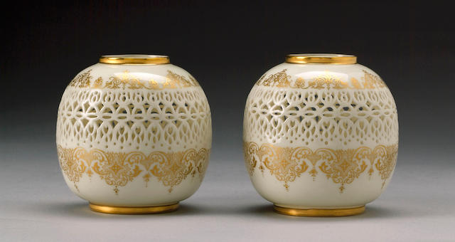 A pair of Royal Worcester reticulated vases by George Owen dated 1917