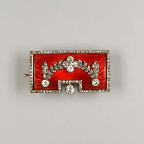An enamel and diamond brooch by Fabergé