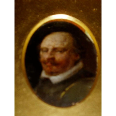 English School (17th Century) A gentleman, bust length, with white ruff and green coat oval 58mm, in a moulded giltwood frame
